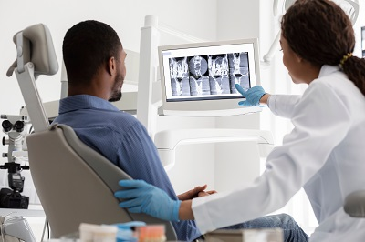 patient looking at dental x-rays in dental office