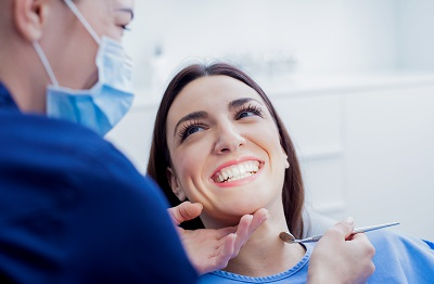 woman getting dental inspection