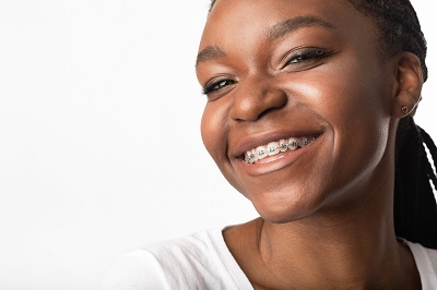 Image of African American woman with braces smiling