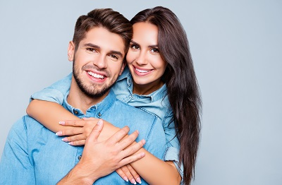 happy young couple in blue background