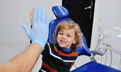 Image of happy young boy at dentist office