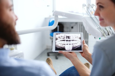 Image of patient looking at dental x-ray